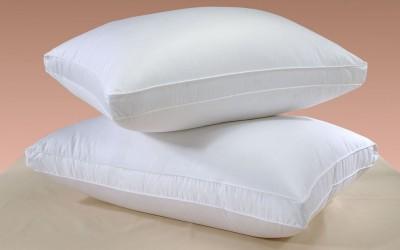 Како да ги исперете пожолтените перници
