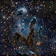 """Ова е нова перспектива на славната колепка so ѕвезди """"Столбови на создавањето"""" - темните области ги претставуваат ѕвездите кои наскоро ќе почнат да сјаат"""