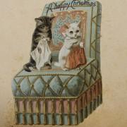 Среќен Божиќ од две тажни мачиња