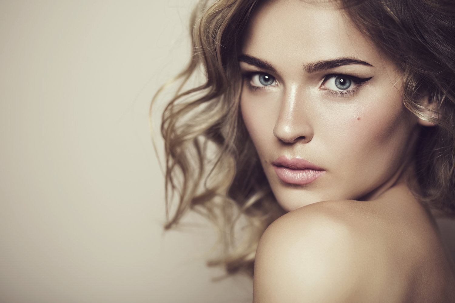 Beautiful woman with professional makeup and hair